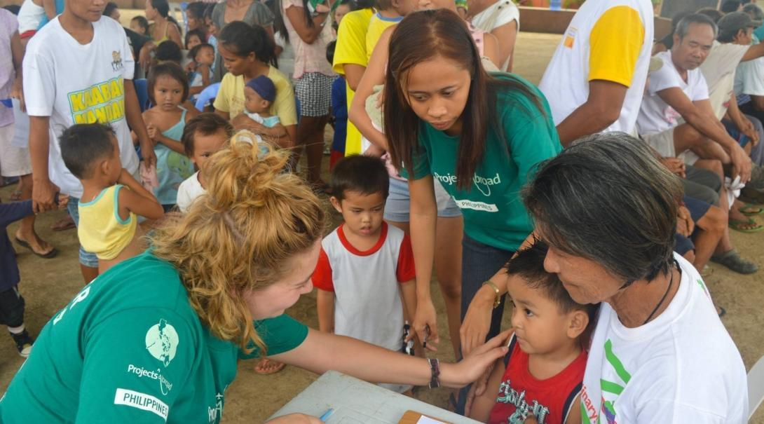 Public Health intern talking to her patient during a community outreach.